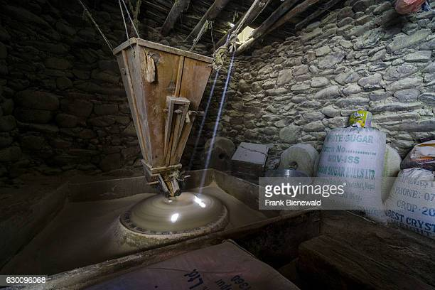 A traditional mill powered by water power is milling grains
