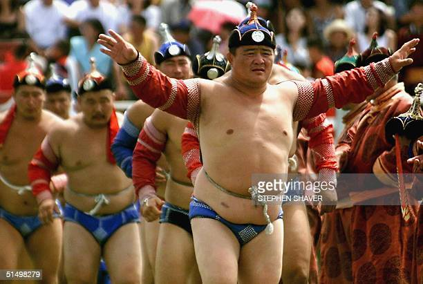 Traditional Mongolian wrestlers perform the Eagle Dance before their Nadaam wrestling matches 12July 2000 in Ulan Bator as the whole of Mongolia...