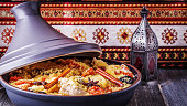 Traditional moroccan tajine of chicken with dried fruits and spices, selective focus.