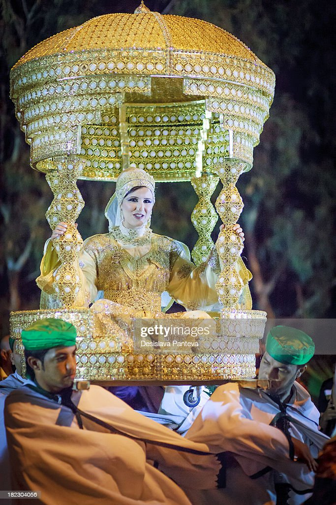 CONTENT] Traditional moroccan wedding - The bride, sitting on a special circular cushion or table, on the shoulders of friends of the groom, was carried to the bridal chamber.