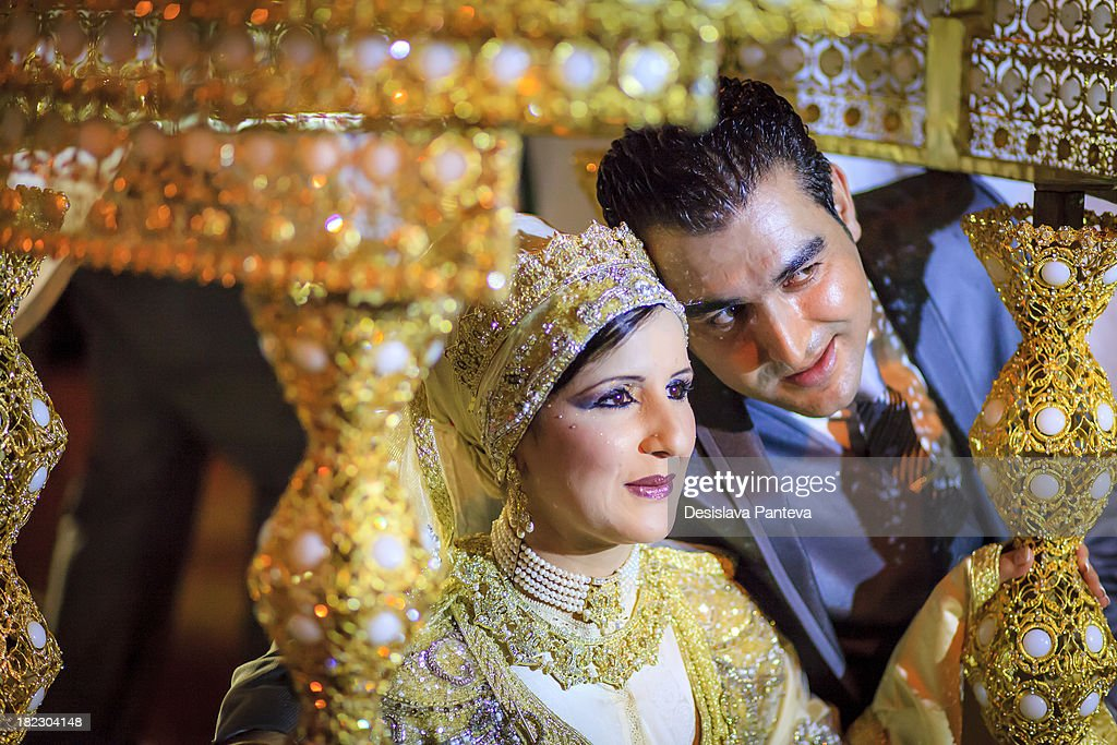 CONTENT] Traditional moroccan wedding - the marriage celebration includes several well organized ceremonies - The bride and the groom sitting on a special circular cushion or table.