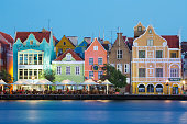 Traditional multi colored town houses on waterfront at dusk, Punda, Willemstad, Curacao, Caribbean