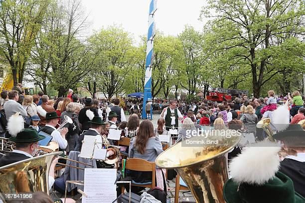 A traditional music group performs during the traditional Bavarian maypole raising in Ismaning on May 1 2013 in Munich Germany The tradition of...