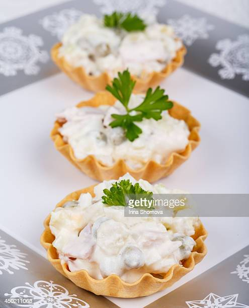 Traditional New Year's salad olivier in tartlets