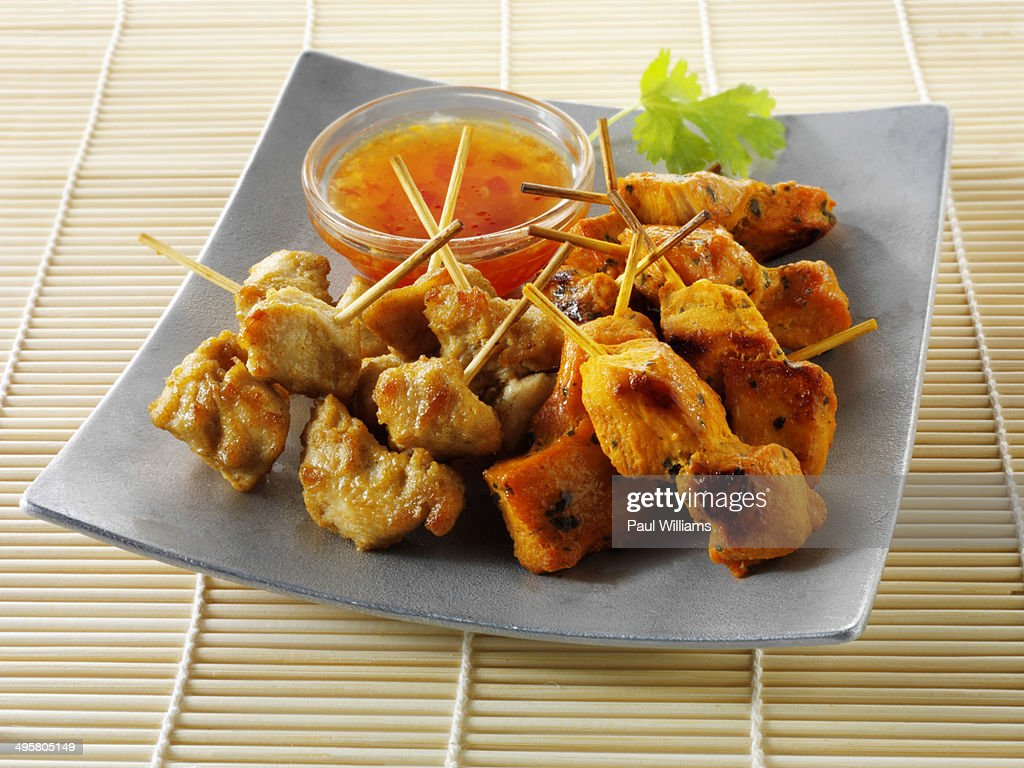 Traditional oriental satay skewers with chilli dip : Stock Photo