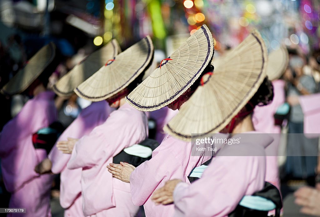 Traditional Owara dancers perform at the Tanabata festival on July 6, 2013 in Tokyo, Japan. Tanabata is a Japanese star festival where people dress in traditional 'yukata' robes and write their wishes on strips of paper to hang on bamboo trees.