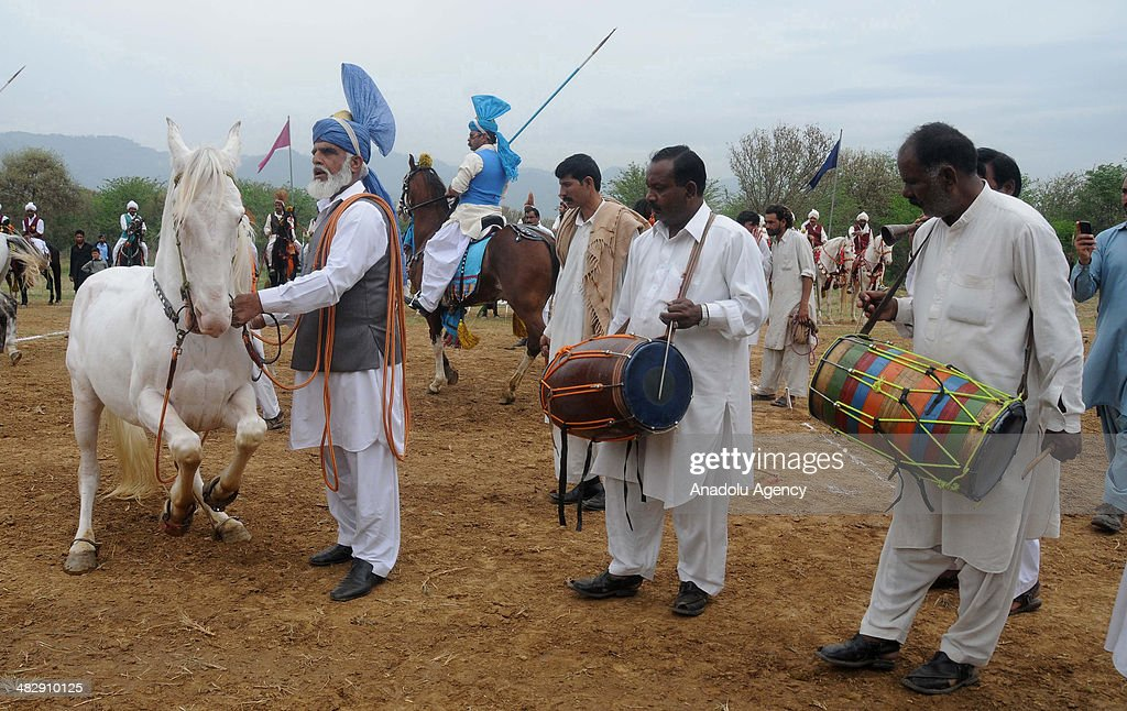 Traditional Pakistani musicians play their instrument prior to tentpegging on April 5 in Islamabad Pakistan The traditional Pakistani game is known...