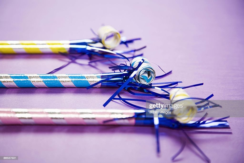 Traditional party blowers : Stock Photo