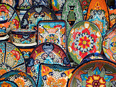Colourful traditional pottery on sale at street market and souvenir shop in San Miguel de Allende, Guanajuato, Mexico.