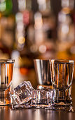 Traditional pure vodka in glasses on a black background, chilled drink, nightlife