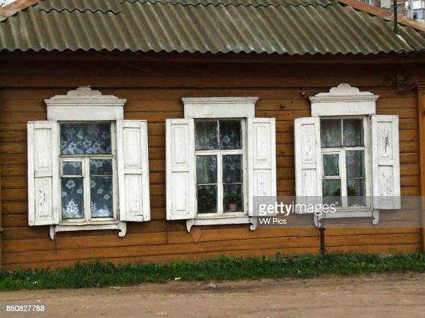 A traditional Russian house made of wood or timbers and with nalichniki fancy decorative wood trim around the windows Usually there are three windows...