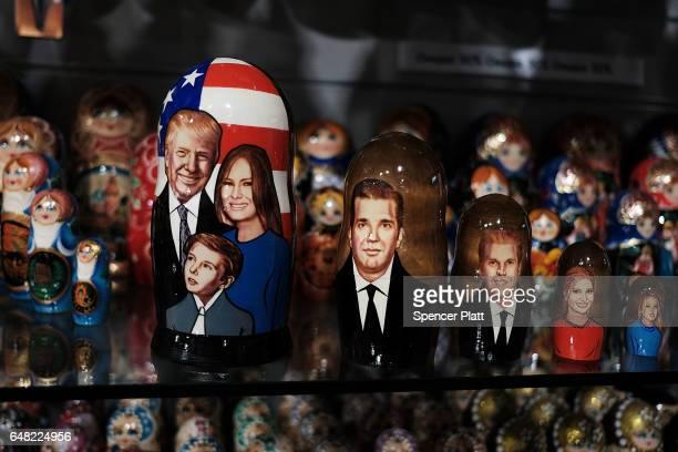 A traditional Russian nesting doll painted with the likeness of President of Donald Trump and his family is displayed for sale at a Moscow store on...