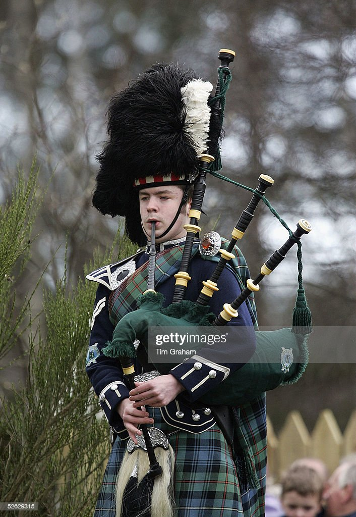 Traditional Scottish bagpipes player welcomes the royal couple to the opening of the Monaltrie Park children's playground in Ballater. on April 14, 2005 in Aberdeenshire, Scotland.
