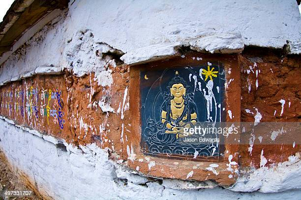 A traditional slate carving of Buddha Amitabha on a Buddhist temple.