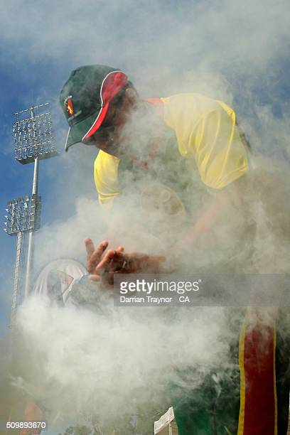A traditional smoking ceremony takes place during day 6 of the National Indigenous Cricket Championships on February 13 2016 in Alice Springs...