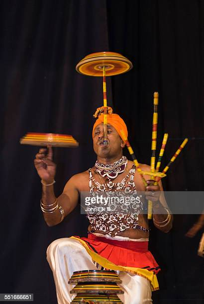 Traditional Sri Lankan dancer spinning plates