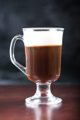 traditional strong irish coffee on wooden bar