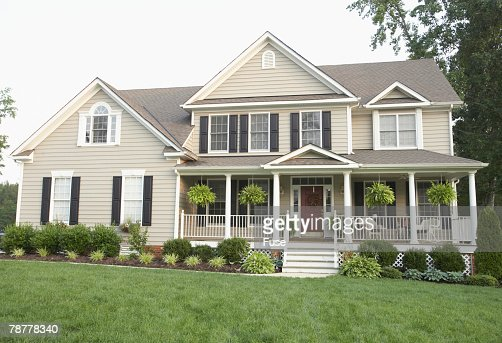 Traditional style house with large front porch stock photo for Homes with large porches