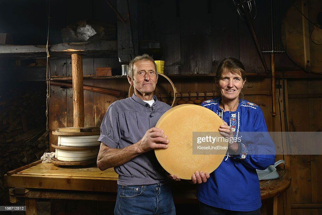 Traditional Swiss cheese making : Stock Photo