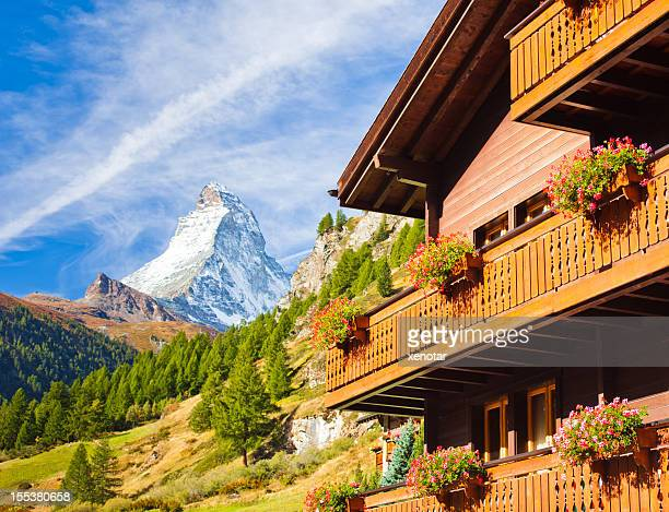 Traditional Swiss house and the Matterhorn behind
