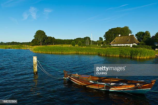 traditional thatched roof house with boat