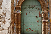 Traditional turquoise riad door in medina, Morocco