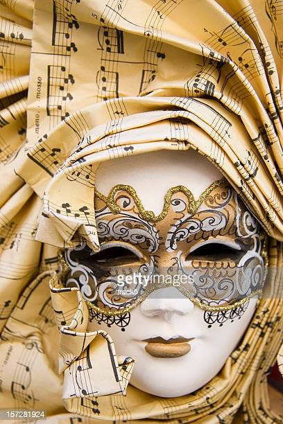 Traditional Venetian carnival mask with a musical theme