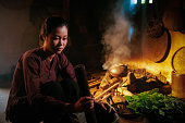 Traditional Vietnamese woman at cooking