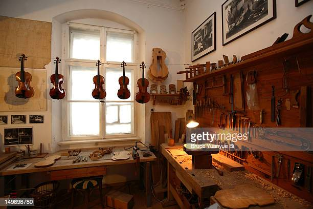 Traditional violin workshop display in Fussen City Museum.