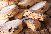 Traditional Welsh cakes with raisins and powdered sugar macro on the table. Horizontal