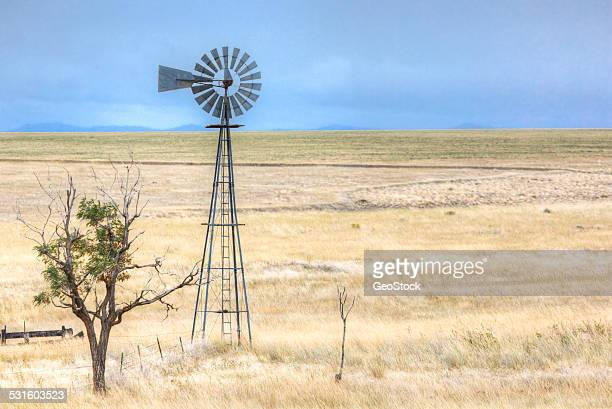 A traditional windmill in a prairie landscape