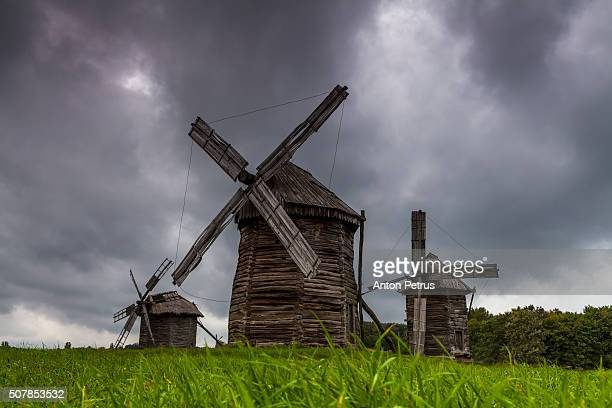 Traditional windmill on the background of dramatic sky