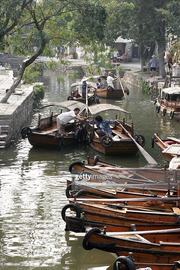 Traditional wooden boats in ancient canal town. : Stock Photo