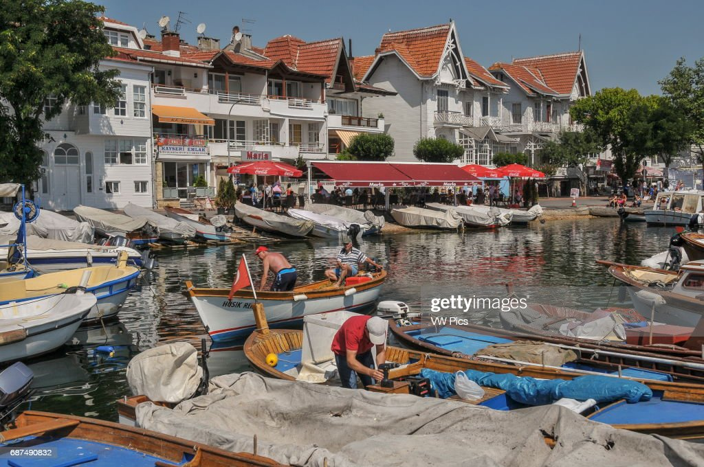 Traditional wooden houses by the small harbour on K›nal›ada. K›nal›ada is one of the Prince Islands, a small archipelago on the Sea of Marmara. It is located a short boat ride from Istanbul city center and is a popular destination for those wishing to escape from the overcrowded megapolis, especially during the summer months.