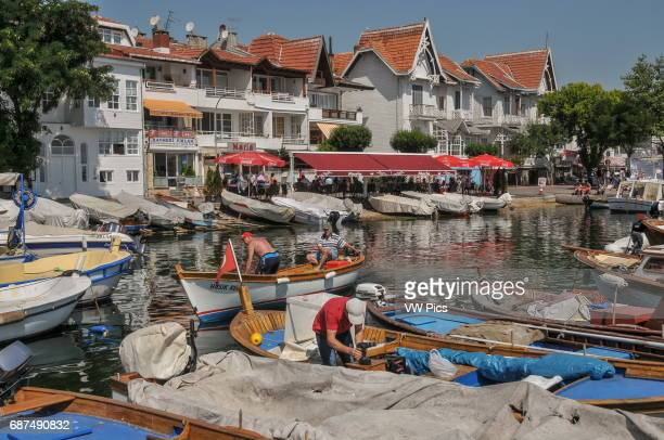 Traditional wooden houses by the small harbour on K›nal›ada K›nal›ada is one of the Prince Islands a small archipelago on the Sea of Marmara It is...