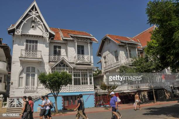 Traditional wooden houses near the small harbour on K›nal›ada K›nal›ada is one of the Prince Islands a small archipelago on the Sea of Marmara It is...