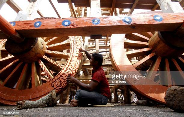 Traditional workers of the Shree Jagannath temple busy to built wooden chariots and applying colors into it it ahead of the Three deities annual...