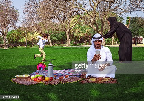 Traditional Young Arabic Family Having Fun Outdoors At ...