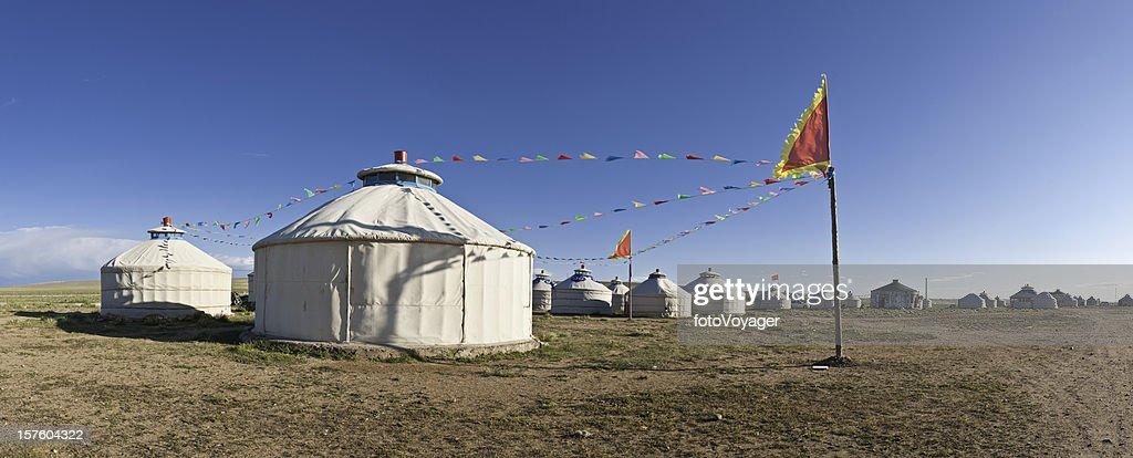 Traditional yurt tent village flags Inner Mongolian grasslands panorama China