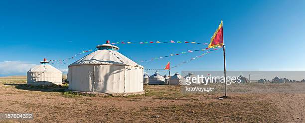 Traditional yurt tent village flags Inner Mongolian grasslands panorama China