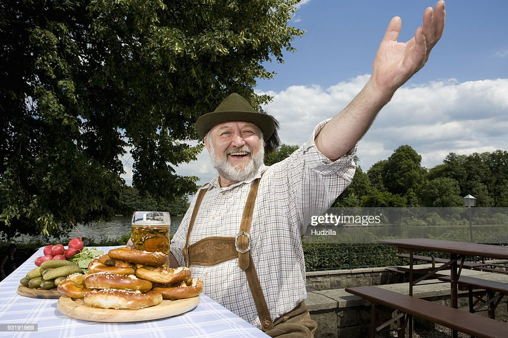 A traditionally clothed German man in a beer garden