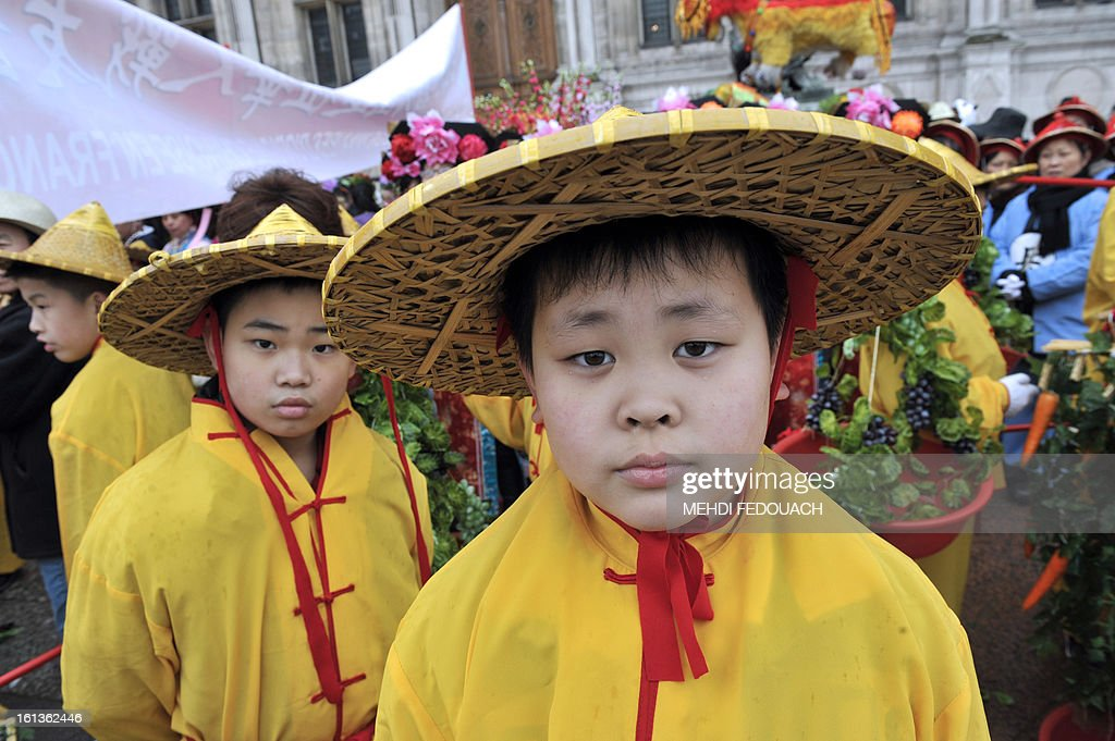 Traditionally dressed children pose as they celebrate Chinese New Year on February 10, 2013 during a parade in Paris. Chinese communities world wide traditionally welcomed in the 'Year of the Snake'. AFP PHOTO / MEHDI FEDOUACH