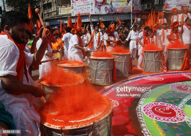 Traditionally dressed Indian men perform during the celebrations of the Gudi Padwa Maharashtrian's New Year in Mumbai India on March 28 2017 Gudi...