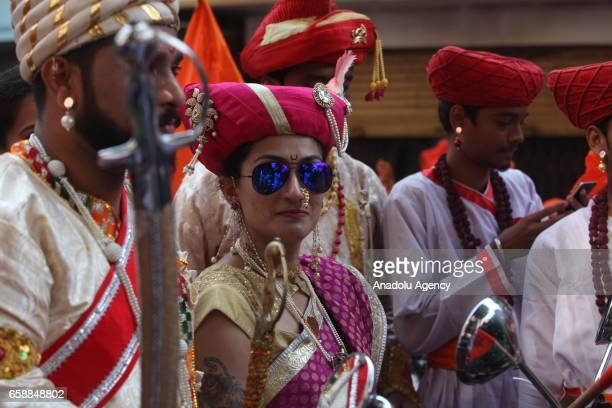 A traditionally dressed Indian woman celebrates the Gudi Padwa Maharashtrian's New Year in Mumbai India on March 28 2017 Gudi Padwa is the Hindu...