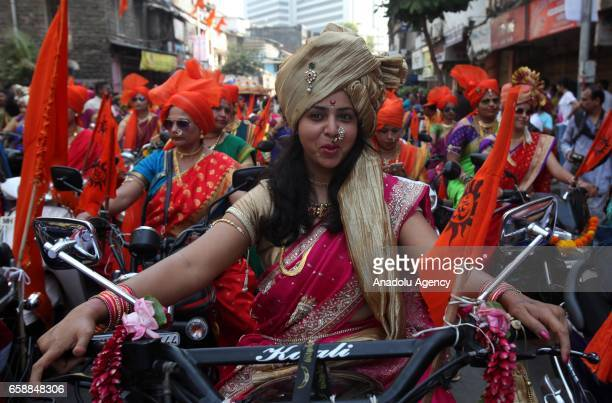 A traditionally dressed Indian woman is seen on a motorbike during the celebrations of the Gudi Padwa Maharashtrian's New Year India on March 28 2017...