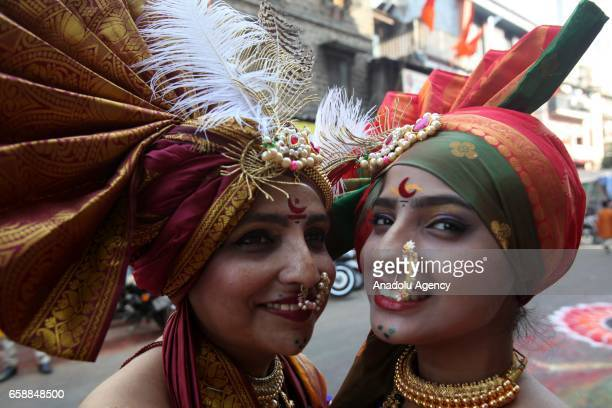 Traditionally dressed Indian women are seen during the celebration of the Gudi Padwa Maharashtrian's New Year in Mumbai India on March 28 2017 Gudi...