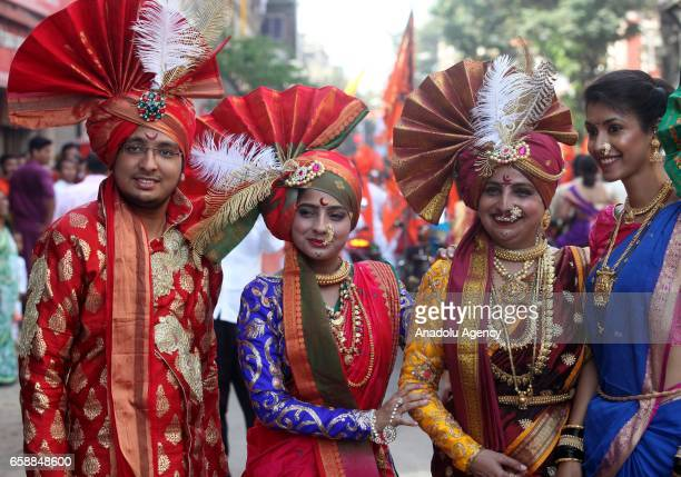 Traditionally dressed Indians are seen during the celebration of the Gudi Padwa Maharashtrian's New Year in Mumbai India on March 28 2017 Gudi Padwa...