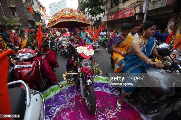 Traditionally dressed Indians are seen on motorbikes during the celebration of the Gudi Padwa Maharashtrian's New Year in Mumbai India on March 28...