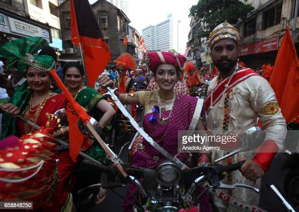 Traditionally dressed Indians celebrate the Gudi Padwa Maharashtrian's New Year in Mumbai India on March 28 2017 Gudi Padwa is the Hindu festival...