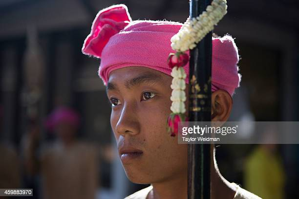 A traditionally dressed Thai man takes part in a parade and ceremony in honor of the King's birthday on December 3 2014 in Chiang Mai Thailand...